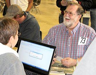 Man registering for auction