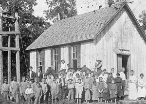 Students outside an early Oklahoma schoolhouse