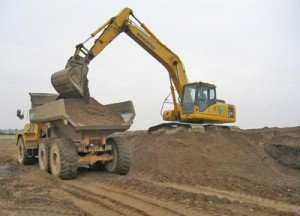 Machinery loading dirt into dumptruck